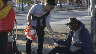 Krishna Food Relief Serves the Homeless Sandwiches, Socks and the Holy Name